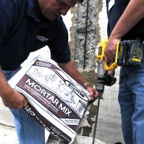 A Man Holding A Bag of Mortar Mix - Concrete Australia - Antoun