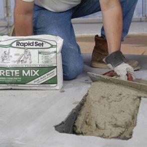 A Worker Hand With Trowel Leveling the Rapid Set Concrete Mix - Civil Works Construction - Antoun
