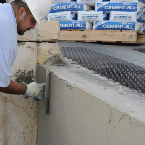 A Worker Spreading Concrete - - Civil Engineering Works - Antoun
